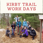"photo of volunteers on a mulch pile, with a banner reading"" Kirby Trail Work Days"""
