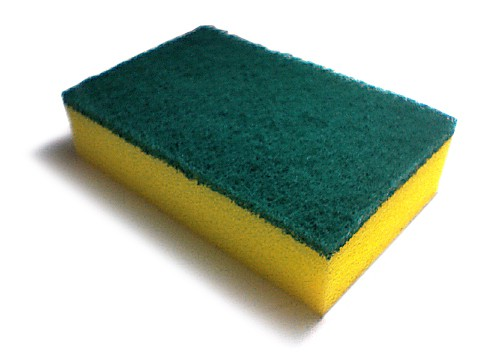 A yellow plastic sponge with a green scrubby top